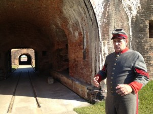 A military docent explains the wartime efforts at Fort Morgan.